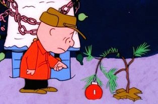 CHARLIE BROWN TRIES TO PERK UP THE FORLORN LITTLE CHRISTMAS TREE